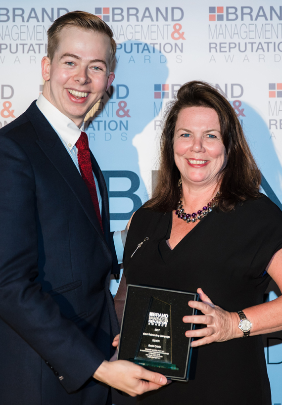 Lesley Piner, Head of Group Business Development and Marketing receiving the award from Comedian, Chris Turner.